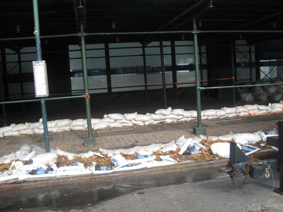 Sand bags line the street in downtown New York.  (Jana Kasperkevic / Houston Chronicle)