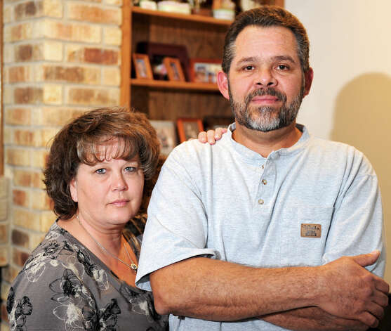 Jose Hernandez, shown with his wife, Leisa, was arrested at his Northwest Side home Oct. 22 by Bexar County sheriff's deputies with a warrant out of Harris County for another man with the same name and date of birth. Photo: JOHN ALBRIGHT, San Antonio Express-News / San Antonio Express-News