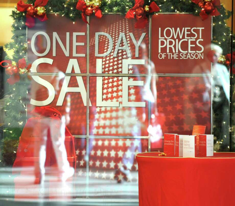 Sale signs were prevalent at Macy?s in Colonie Center in Colonie, N.Y. Monday afternoon, Nov. 12, 2012. Veterans Day sales could be seen as a weathervane for the upcoming holiday season. (Will Waldron /Times Union) Photo: Will Waldron