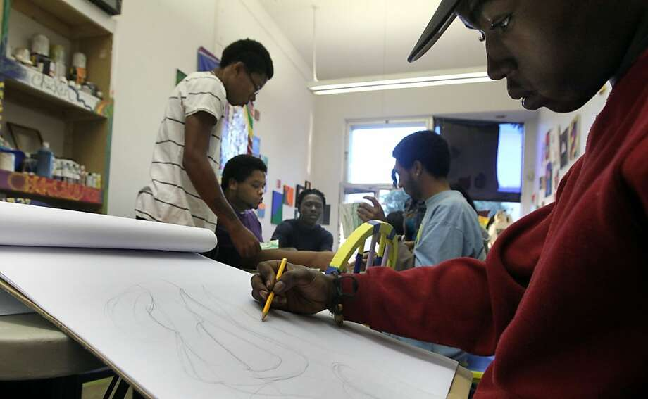 Cole Wright sketches out a painting at Youth Spirit Artworks, an East Bay nonprofit that helps at-risk youth find housing, jobs and education. Photo: Lance Iversen, The Chronicle
