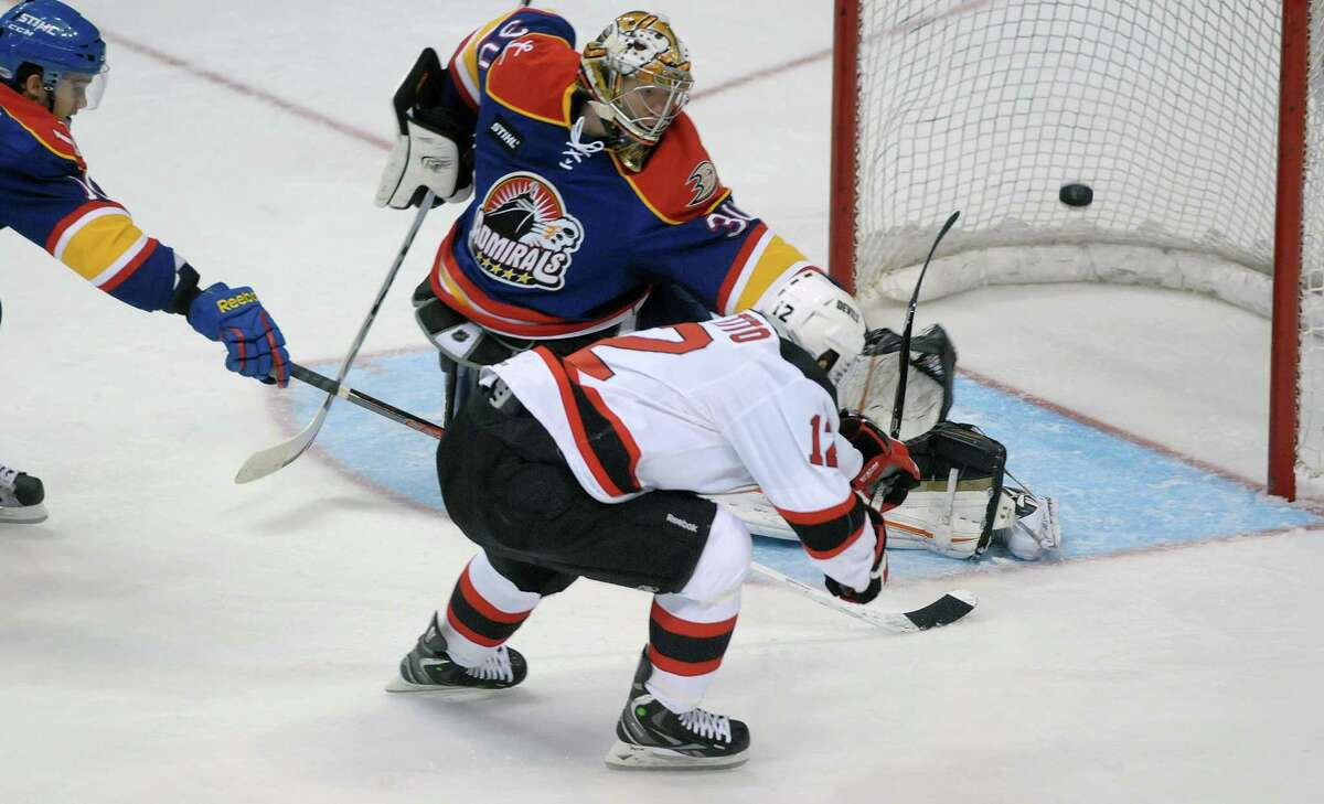 Frederik Andersen, background, goaltender of the Norfolk Admirals reaches out but misses to stop a shot on goal by Tim Sestito of the Albany Devils during their hockey game at the Times Union Center on Monday, Nov. 12, 2012 in Albany, NY. (Paul Buckowski / Times Union)