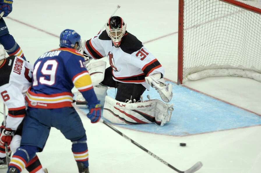 Jeff Frazee, goaltender of the Albany Devils moves to make a save on a shot by a player with the Nor