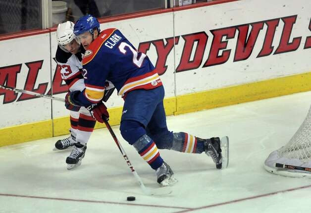 Darcy Zajac, left, of the Albany Devils reaches around Mat Clark of the Norfolk Admirals to control the puck during their hockey game at the Times Union Center on Monday, Nov. 12, 2012 in Albany, NY.   (Paul Buckowski / Times Union) Photo: Paul Buckowski