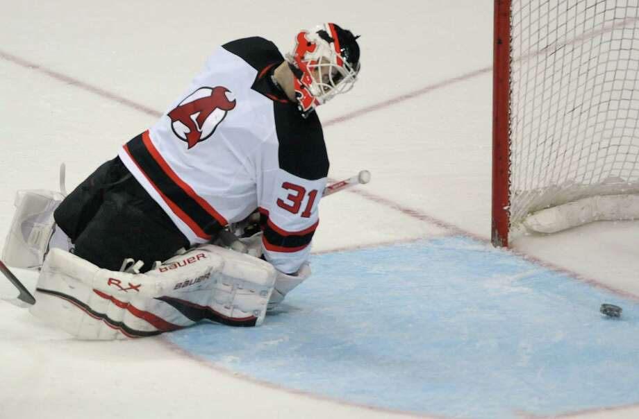 Jeff Frazee, goaltender of the Albany Devils looks back to see the puck enter the net for a score  on a shot by a player with the Norfolk Admirals during their hockey game at the Times Union Center on Monday, Nov. 12, 2012 in Albany, NY.   (Paul Buckowski / Times Union) Photo: Paul Buckowski