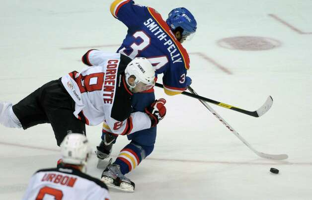 Matthew Corrente, left, of the Albany Devils tries to stop ryan Parent of the Norfolk Admirals during their hockey game at the Times Union Center on Monday, Nov. 12, 2012 in Albany, NY.   (Paul Buckowski / Times Union) Photo: Paul Buckowski  / 00020021A