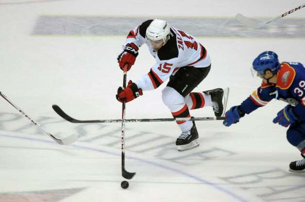 Steve Zalewski, left, of the Albany Devils brings the puck up the ice past Corey Elkins of the Norfolk Admirals during their hockey game at the Times Union Center on Monday, Nov. 12, 2012 in Albany, NY.   (Paul Buckowski / Times Union) Photo: Paul Buckowski