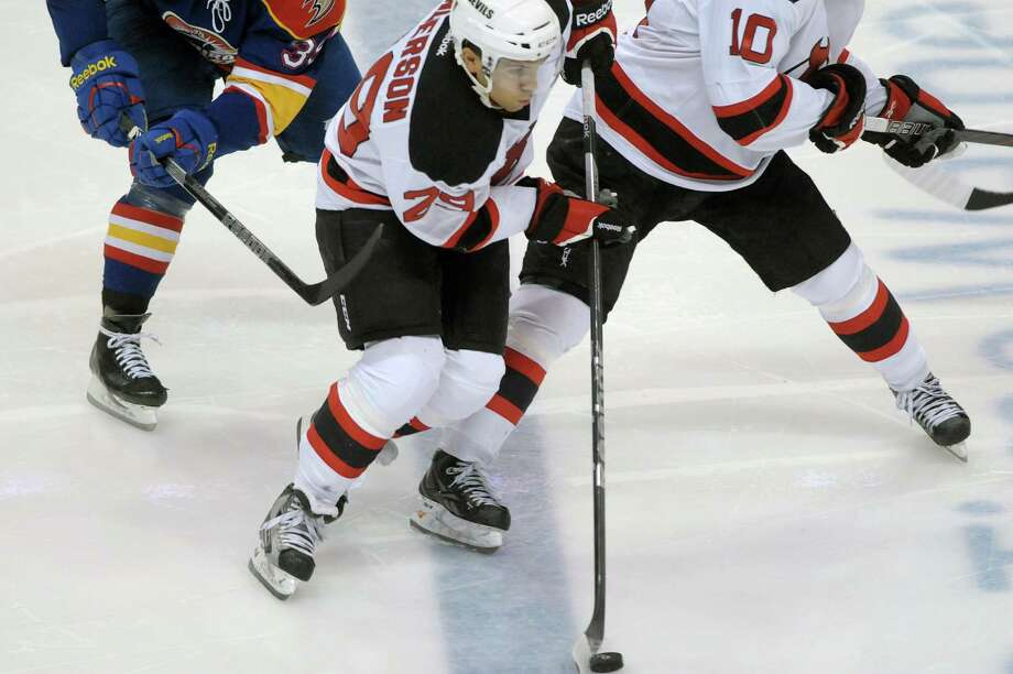 Matt Anderson of the Albany Devils brings the puck up the ice past Norfolk Admirals defenders during their hockey game at the Times Union Center on Monday, Nov. 12, 2012 in Albany, NY.   (Paul Buckowski / Times Union) Photo: Paul Buckowski