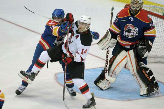 Chris Wagner, left, of the Norfolk Admirals and  Adam Henrique of the Albany Devils fight for position in front of the net during their hockey game at the Times Union Center on Monday, Nov. 12, 2012 in Albany, NY.   (Paul Buckowski / Times Union) Photo: Paul Buckowski