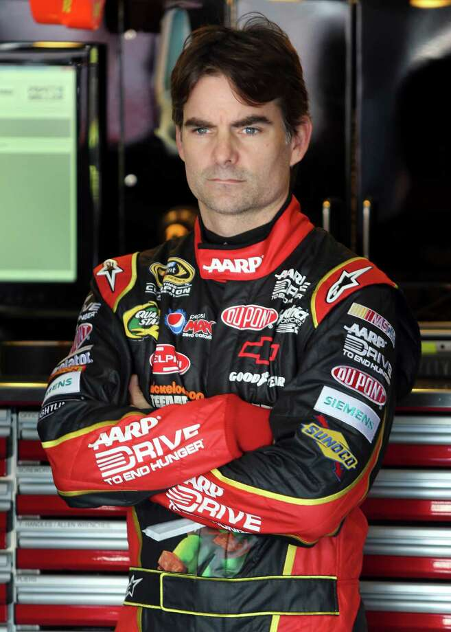 FILE - In this Oct. 12, 2012 file photo, Jeff Gordon waits before practice for the NASCAR Bank of America 500 Sprint Cup series auto race in Concord, N.C. NASCAR has a real dilemma on its hands with this whole Gordon mess hanging over the season finale, Sunday, Nov. 18, 2012 at Homestead-Miami Speedway.  (AP Photo/Bob Jordan, File) Photo: Bob Jordan