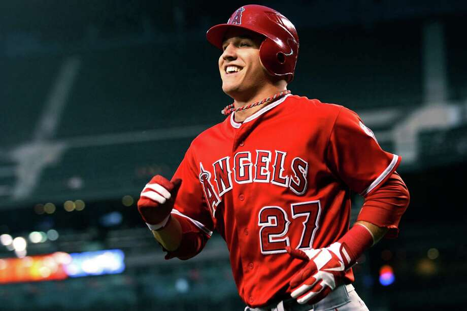 FILE - In this Aug. 31, 2012, file photo, Los Angeles Angels' Mike Trout smiles after scoring against the Seattle Mariners during a baseball game in Seattle. Trout unanimously won the American League Rookie of the Year Monday, Nov. 12. (AP Photo/Elaine Thompson, File) Photo: Elaine Thompson