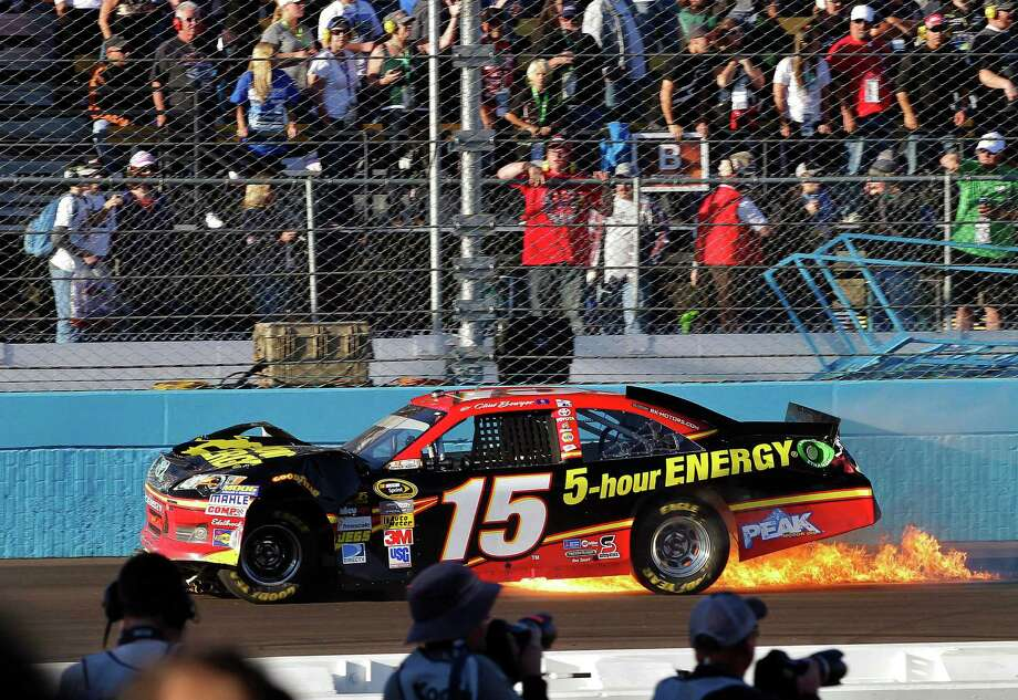 Clint Bowyer stops along the front straightaway after being hit by Jeff Gordon in a dustup between the two drivers during Sunday's Sprint Cup race at Phoenix International Raceway in Avondale, Ariz. Photo: Matt York, STF / AP