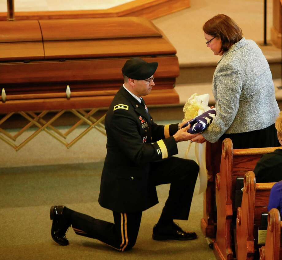 Maj. Gen. William Buckler presents the flag from the casket of Sgt. Brett E. Gornewicz, an Army Reservist who was killed Saturday by a roadside bomb in Afghanistan, to his mother, Margaret, during the funeral at St. John the Baptist Church in Alden, Monday, Nov. 12, 2012. (AP Photo/Buffalo News, Derek Gee) Photo: Derek Gee