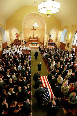 The flag draped casket of Sgt. Brett E. Gornewicz, an Army Reservist who was killed Saturday by a roadside bomb in Afghanistan, is carried into St. John the Baptist Church in Alden at the start of funeral services, Monday, Nov. 12, 2012. (AP Photo/Buffalo News, Derek Gee) Photo: Derek Gee