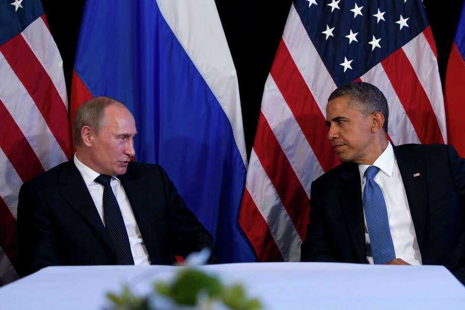 FILE - This June 18, 2012 file photo shows President Barack Obama meeting with Russia's President Vladimir Putin, in Los Cabos, Mexico. Tensions between the U.S. and Russia have been rising. The countries have been at odds over Syria's civil war, Iran's nuclear program and Russia's crackdown on domestic opposition. U.S. officials are uneasy about what they see as a more assertive foreign policy by Vladimir Putin, who returned to the Russian presidency in May. (AP Photo/Carolyn Kaster, File) Photo: Carolyn Kaster