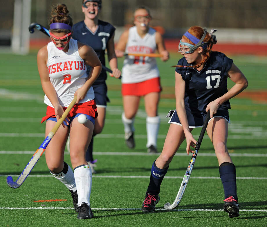 From left, Niskayuna's Ali Frary tries to get control of the ball while Suffern's Sarah Adler defends her during the section 2 Class A regional field hockey game on Monday, Nov. 12, 2012 in Schuylerville, N.Y.  (Lori Van Buren / Times Union) Photo: Lori Van Buren