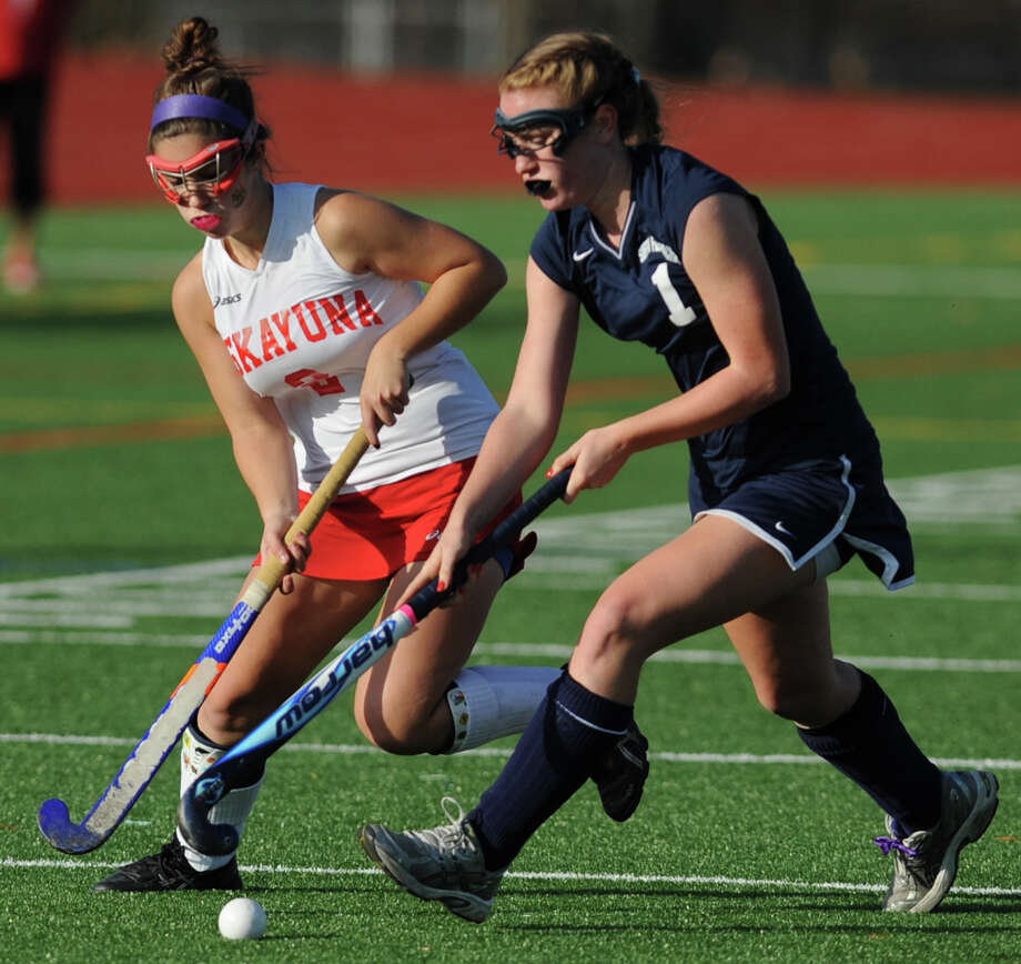 From left, Niskayuna's Ali Frary battles for the ball with Suffern's Amy McNally during the section 2 Class A regional field hockey game on Monday, Nov. 12, 2012 in Schuylerville, N.Y.  (Lori Van Buren / Times Union) Photo: Lori Van Buren