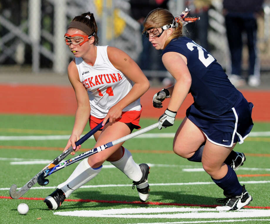 From left, Niskayuna's Ali Wells battles for the ball with Suffern's Taylor Feug during the section 2 Class A regional field hockey game on Monday, Nov. 12, 2012 in Schuylerville, N.Y.  (Lori Van Buren / Times Union) Photo: Lori Van Buren