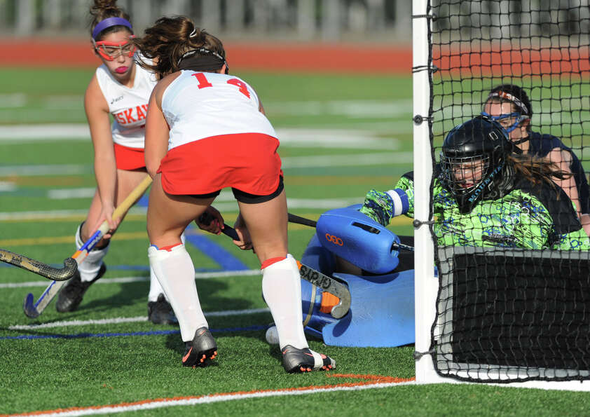 Niskayuna players try to get the ball past Suffern's keeper Kaila Cahoon during Class A regional fie
