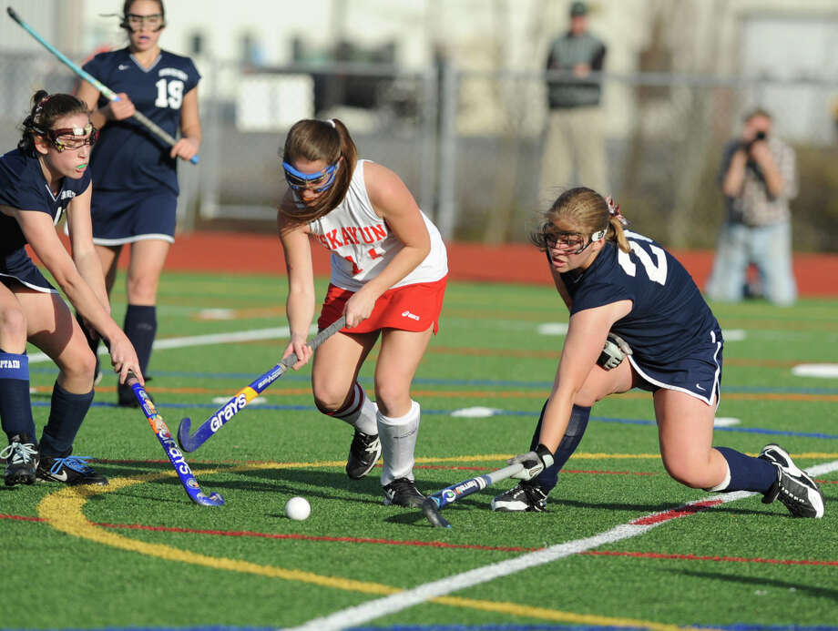 Niskayuna's Anna Torri, center, tries to keep the ball away from Suffern players during the section 2 Class A regional field hockey game on Monday, Nov. 12, 2012 in Schuylerville, N.Y.  (Lori Van Buren / Times Union) Photo: Lori Van Buren
