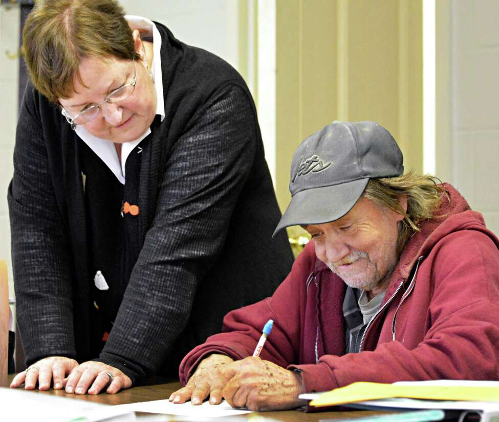 Teacher Judy Conine, left, with student Robert Snyder of Hudson during her adult education class at the First Reformed Church in Hudson Tuesday Oct. 30, 2012. (John Carl D'Annibale / Times Union)