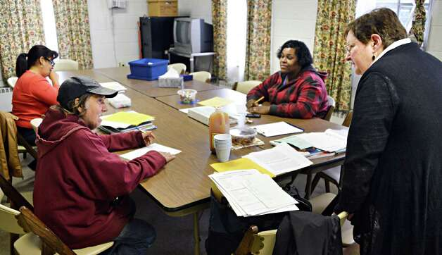 Teacher Judy Conine, at right, with students, from left, Lucy Vargas, Robert Snyder, and Tiffany Jackson during adult education class at the First Reformed Church in Hudson Tuesday Oct. 30, 2012. (John Carl D'Annibale / Times Union) Photo: John Carl D'Annibale / 00019890A