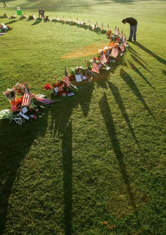 A mourner visits the makeshift memorial to the slain students and faculty on the campus of Virginia Tech in Blacksburg, Va., Sunday, April 22, 2007. Student Seung-Hui Cho shot and killed 32 people before committing suicide on Monday, April 16, 2007. (AP Photo/Robert F. Bukaty) Photo: Robert F. Bukaty, ASSOCIATED PRESS / AP2007 ASSOCIATED PRESS