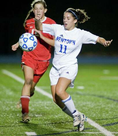 Newtown High School's Brittany Tolla tries to settle the ball in a Class LL game against Greenwich High School, played at Newtown. Monday, Nov. 12, 2012 Photo: Scott Mullin