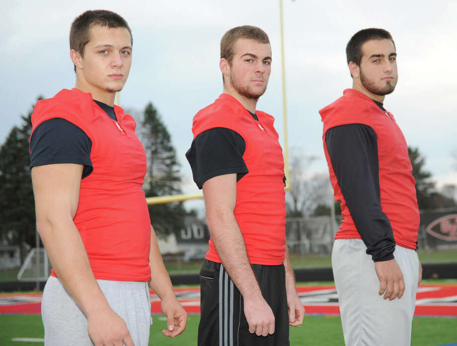 From left, cousins Matt, Cam and Lee Girard , football players for Glens Falls High School, pose for a photo on Monday, Nov. 12, 2012 in Glens Falls, N.Y.  (Lori Van Buren / Times Union) Photo: Lori Van Buren