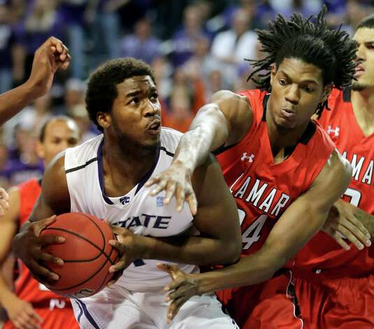 Lamar's Amos Wilson, right, tries to steal the ball from Kansas State's Nino Williams during the first half of an NCAA college basketball game, Monday, Nov. 12, 2012, in Manhattan, Kan. (AP Photo/Charlie Riedel) Photo: Charlie Riedel, STF / AP