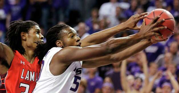 Lamar's Amos Wilson, left, and Kansas State's D.J. Johnson battle for a rebound during the first half of an NCAA college basketball game, Monday, Nov. 12, 2012, in Manhattan, Kan. (AP Photo/Charlie Riedel) Photo: Charlie Riedel, STF / AP