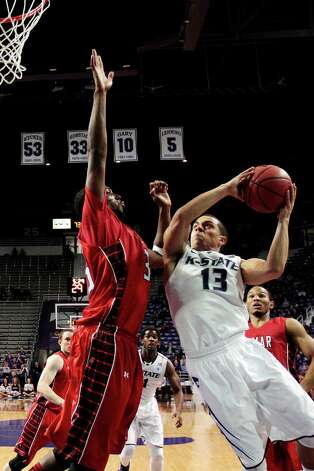 Kansas State's Angel Rodriguez (13) shoots past Lamar's Stan Brown during the second half of an NCAA college basketball game, Monday, Nov. 12, 2012, in Manhattan, Kan. Kansas State won 79-55. (AP Photo/Charlie Riedel) Photo: Charlie Riedel, STF / AP