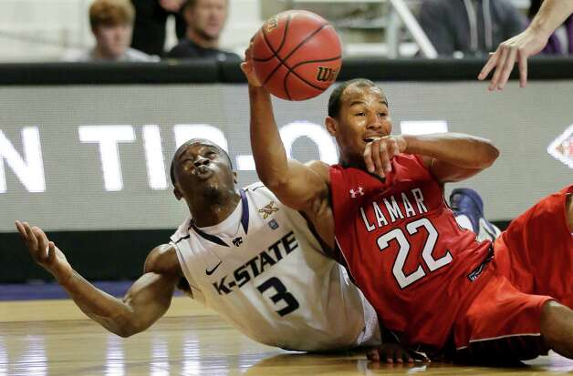 Lamar's Donley Minor (22) passes the ball under pressure from Kansas State's Martavious Irving during the second half of an NCAA college basketball game, Monday, Nov. 12, 2012, in Manhattan, Kan. Kansas State won 79-55. (AP Photo/Charlie Riedel) Photo: Charlie Riedel, STF / AP