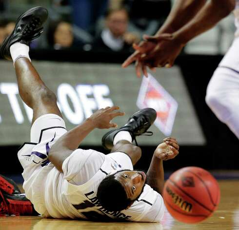 Kansas State's Omari Lawrence passes the ball to a teammate during the second half of an NCAA college basketball game against Lamar, Monday, Nov. 12, 2012, in Manhattan, Kan. Kansas State won 79-55. (AP Photo/Charlie Riedel) Photo: Charlie Riedel, STF / AP
