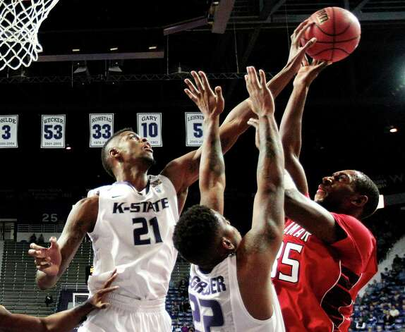 Kansas State's Jordan Henriquez (21) and Rodney McGruder (22) block a shot by Lamar's Stan Brown during the first half of an NCAA college basketball game, Monday, Nov. 12, 2012, in Manhattan, Kan. (AP Photo/Charlie Riedel) Photo: Charlie Riedel, STF / AP