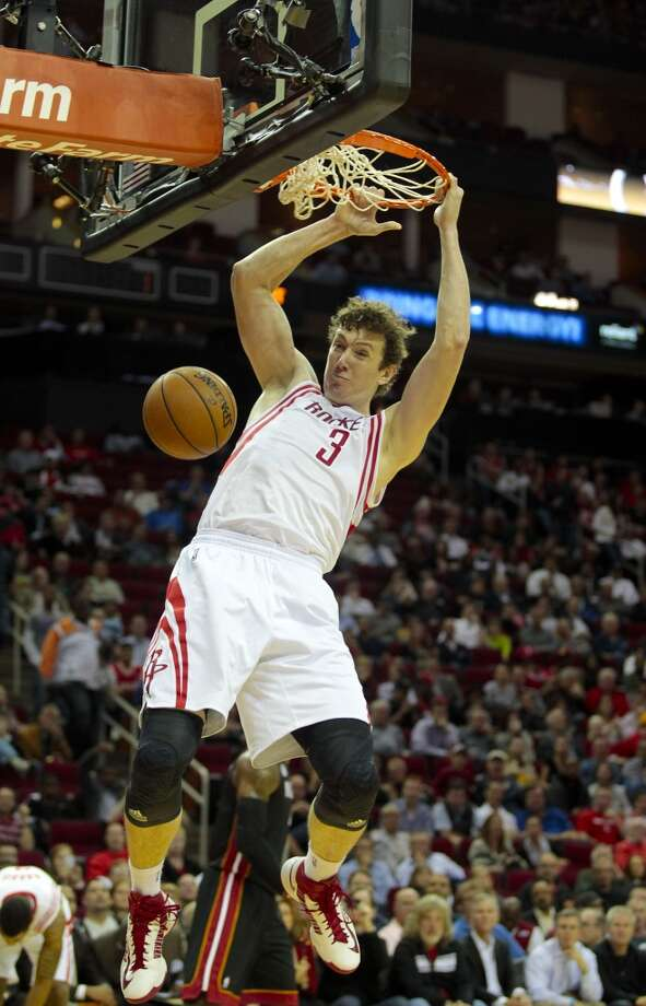 Rockets center Omer Asik (3) gets a dunk in the first quarter.  (Billy Smith II / Houston Chronicle)
