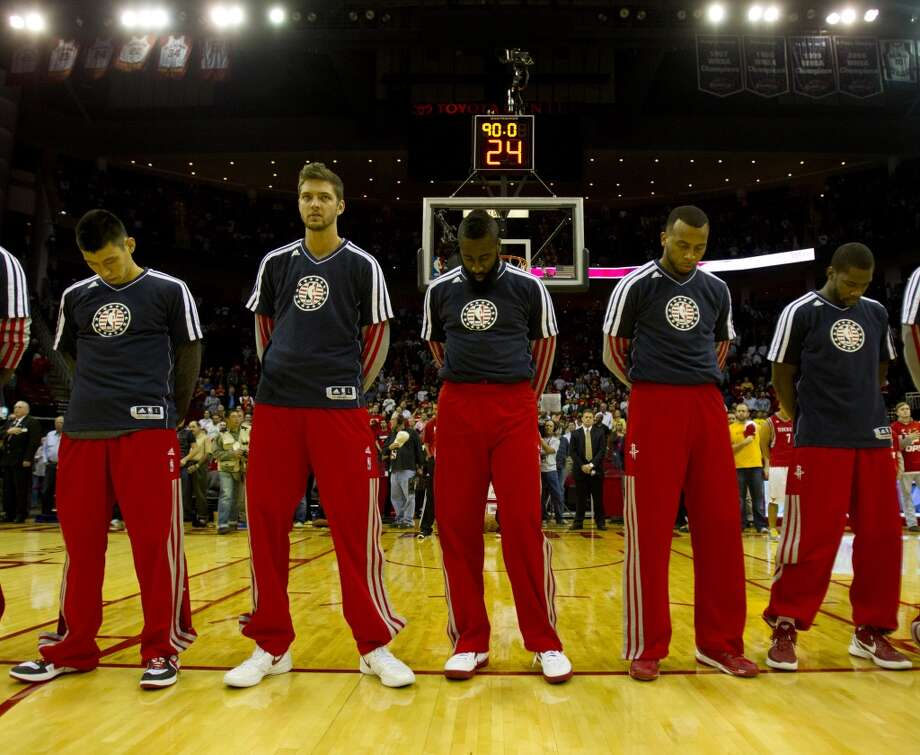 Rockets (l-r) Jeremy Lin, Chandler Parsons, James Harden, Daequan Cook, and Toney Douglas stand in silence during the National Anthem. (Billy Smith II / Houston Chronicle)