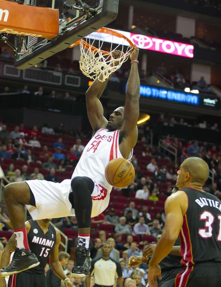 Rockets forward Patrick Patterson (54) dunks on Heat forward Shane Battier.  (Billy Smith II / Houston Chronicle)