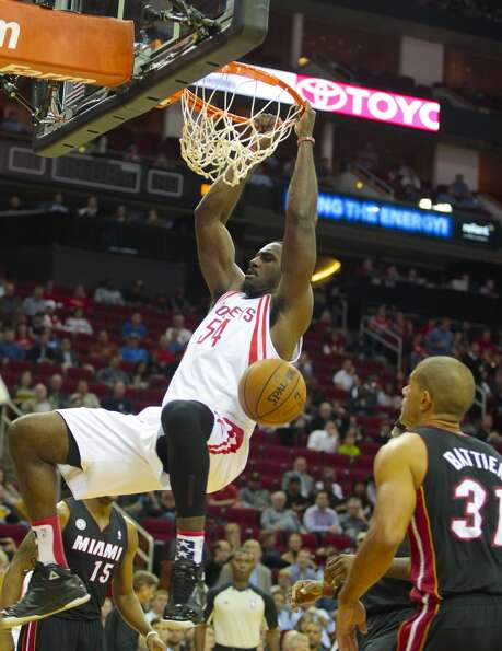 Rockets forward Patrick Patterson (54) dunks on Heat forward Shane Battier.  (Billy Smith II / Houst