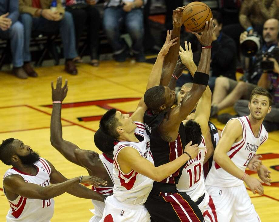 Heat forward Chris Bosh out jumps the Rockets and brings down a crucial rebound with seconds left in the fourth quarter. (Billy Smith II / Houston Chronicle)