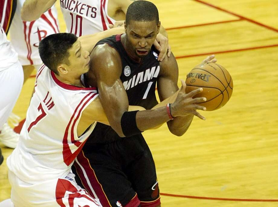 Heat forward Chris Bosh brings down a crucial rebound with seconds left in the fourth quarter. (Billy Smith II / Houston Chronicle)