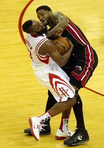 Rockets guard James Harden (13) fights Heat forward Udonis Haslem (40) for the ball. (Billy Smith II