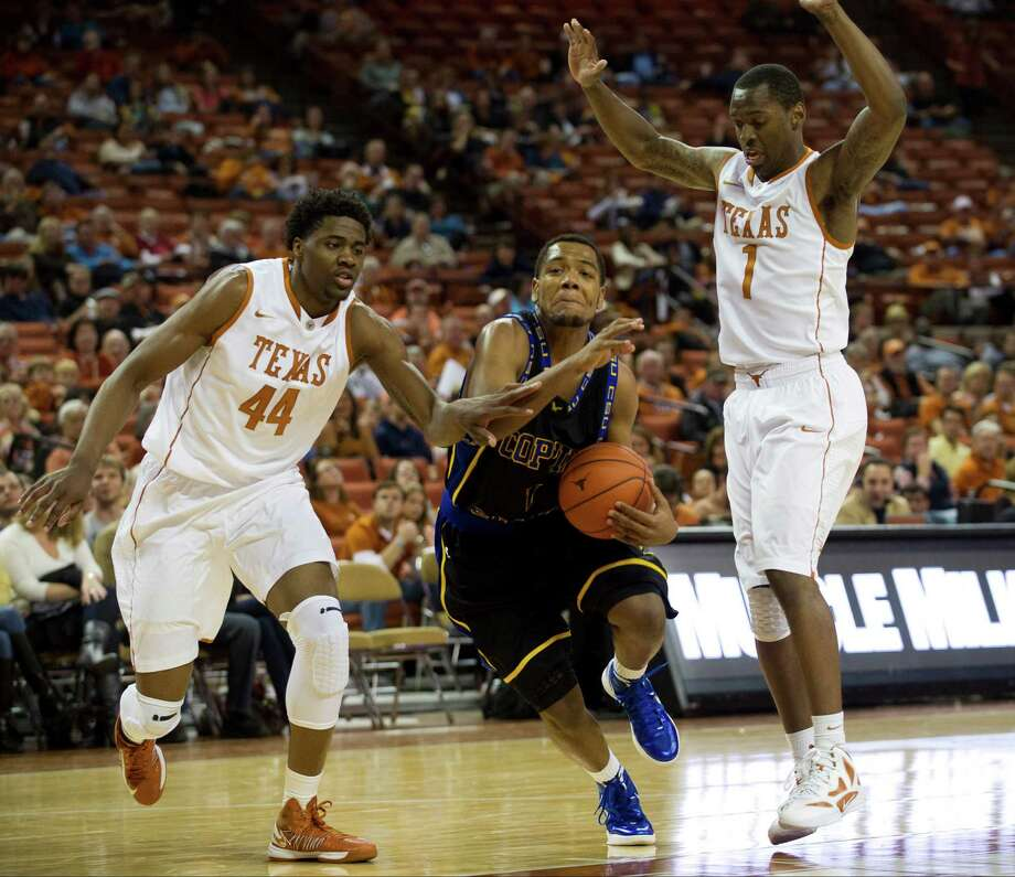 AUSTIN, TX - NOVEMBER 12:  Patrick Cole #1 of the Coppin State University Eagles drives the ball against the University of Texas Longhorns on November 12, 2012 at the Frank Erwin Center in Austin, Texas. Photo: Cooper Neill, Getty Images / 2012 Getty Images