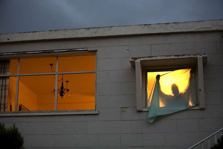 An Israeli man covers the windows of his home with a plastic sheeting after the windows were shattered following an earlier Palestinian rocket attack on the southern Israeli town of Netivot, on November 12, 2012. Gaza militants fired 11 rockets at southern Israel, one of which exploded next to a house, shattering an overnight calm even as Cairo sought to broker an end to 24 hours of bloodshed. Photo: Menahem Kahana, AFP/Getty Images