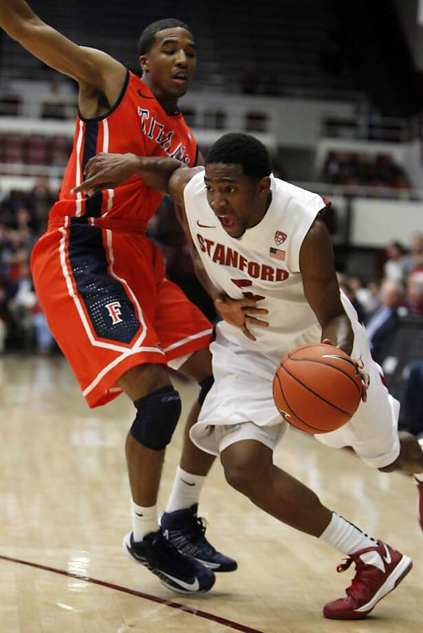 Chasson Randle drives to the basket against Fullerton's Kwame Vaughn in the first period. The Stanford men's basketball team played the Fullerton Titans at Maples Pavilion in Stanford, Calif., on Monday, November 12, 2012. Photo: Carlos Avila Gonzalez, The Chronicle