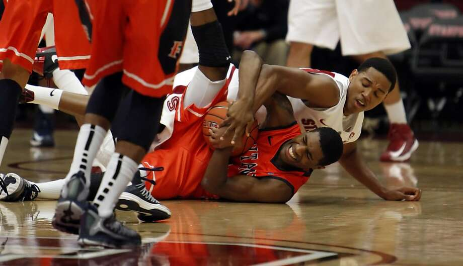 Anthony Brown fights for a loose ball against Fullerton's James Douglas in the first period. The Stanford men's basketball team played the Fullerton Titans at Maples Pavilion in Stanford, Calif., on Monday, November 12, 2012. Photo: Carlos Avila Gonzalez, The Chronicle