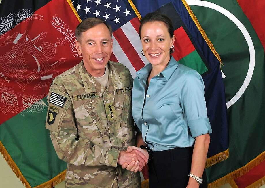 "This July 13, 2011 handout image provide by International Security Assistance Force NATO, shows them ISAF Commander Ge, David Petraeus shaking hands with his biographer Paula Broadwell in Afghanistan.  The plot surrounding the resignation of CIA chief David Petraeus over an extramarital affair thickened November 11, 2012 with reports that his alleged lover had sent emails to a second woman seen as a threat to her love interest. The affair came to light as the FBI was investigating whether a computer used by Petraeus -- the celebrated ex-US commander in Iraq and Afghanistan -- had been compromised, the New York Times and other US media reported, citing government officials. NBC News and others have reported the Federal Bureau of Investigation was focusing on Paula Broadwell, co-author of a favorable biography of Petraeus, for possible improper access to classified information. Unnamed officials told the Times that Petraeus's lover was Broadwell, a former Army major who spent long periods interviewing Petraeus for her book.  AFP PHOTO / HANDOUT / ISAF NATO  = NO SALES = RESTRICTED TO EDITORIAL USE - MANDATORY CREDIT "" AFP PHOTO / ISAF "" - NO MARKETING NO ADVERTISING CAMPAIGNS - DISTRIBUTED AS A SERVICE TO CLIENTS =HO/AFP/Getty Images Photo: Ho, AFP/Getty Images"