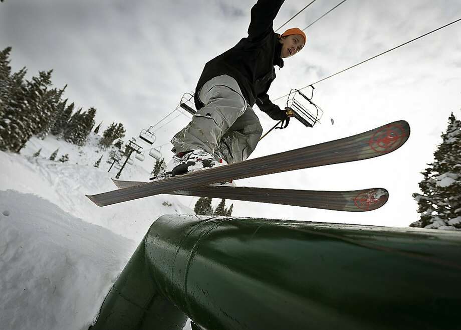 Colby Hine grinds a rail on the Powder Alley run at the Brighton Ski Resort on Monday, Nov. 12, 2012, in Brighton, Utah. Brighton will be the first Wasatch Range ski resort to open its slopes on Nov. 13 for the 2012-13 season. Photo: Ben Brewer, Associated Press