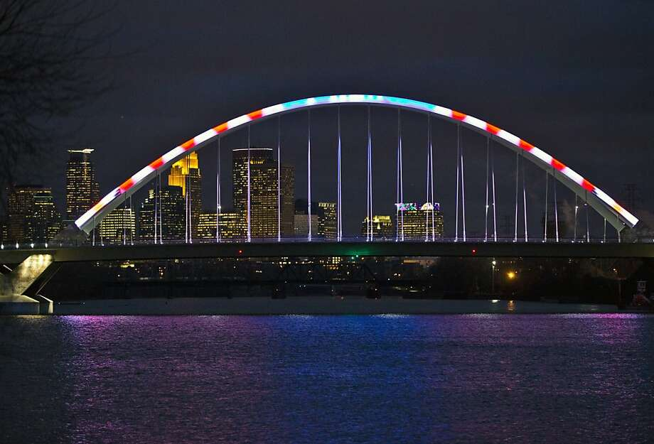 Lowry Avenue Bridge in Minneapolis is lit up red, white and blue in honor of Veterans Day on Monday, Nov. 12, 2012. Photo: Renee Jones Schneider, Associated Press