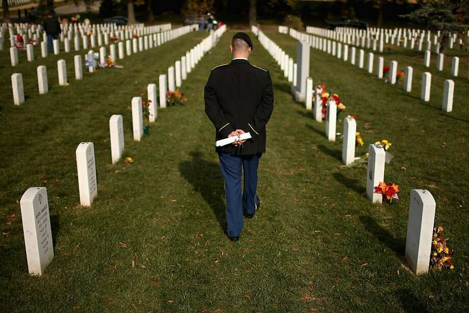 "The day after Veterans Day, U.S. Army Staff Sgt. Luke Parrott walks through the rows of headstones in Section 60 where several of his friends and soldiers he served with are buried at Arlington National Cemetery November 12, 2012 in Arlington, Virginia. A veteran of the wars in Afghanistan and Iraq, Parrott was injured in an IED blast in Baghdad in 2005. Parrott spent time sitting and talking to the graves of the soldiers he knew. ""It's as close as we can get to talking anymore,"" he said. Photo: Chip Somodevilla, Getty Images"