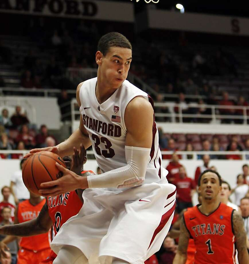 Dwight Powell pulls down a rebound in the second period. The Stanford men's basketball team played the Fullerton Titans at Maples Pavilion in Stanford, Calif., on Monday, November 12, 2012. Stanford won 81-68 Photo: Carlos Avila Gonzalez, The Chronicle
